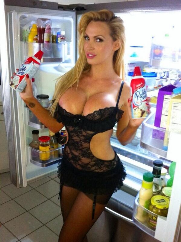 sexy nikki benz nude snapchat pic in black lingerie with bottles of whip cream in her hands