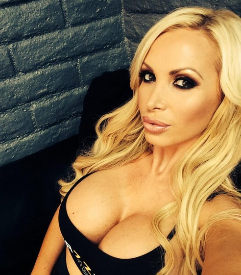 hot social media pic of Nikki Benz and her huge cleavage displayed in a black tank top
