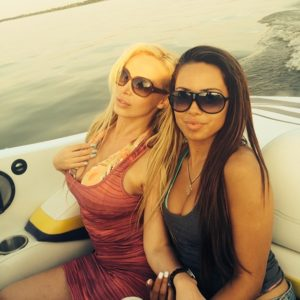 porn star Nikki Benz in a tight pink dress with her friend on a boat