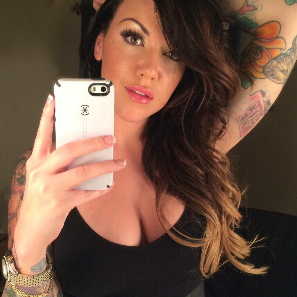 Emily Parker in a black tit shirt taking a selfie
