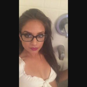 fine jynx maze in glasses taking a selfie