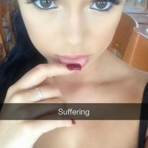 snapchat pic of demi rose with her finger on her mouth