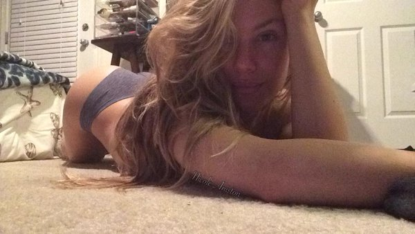 Nicole Aniston laying on the carpet with her booty up in the air