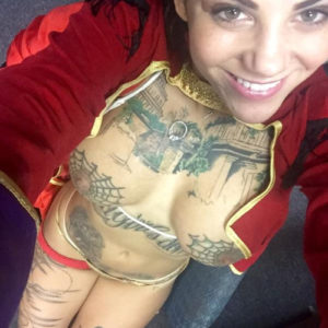 celeb porn star bonnie rotten takes a naked social media pic with her tits out of her red jacket