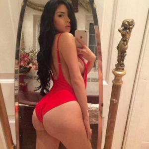 celeb demi rose wears a hot red one piece and takes a booty selfie
