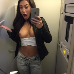 Miss Eva Lovia taking a selfie on an airplane