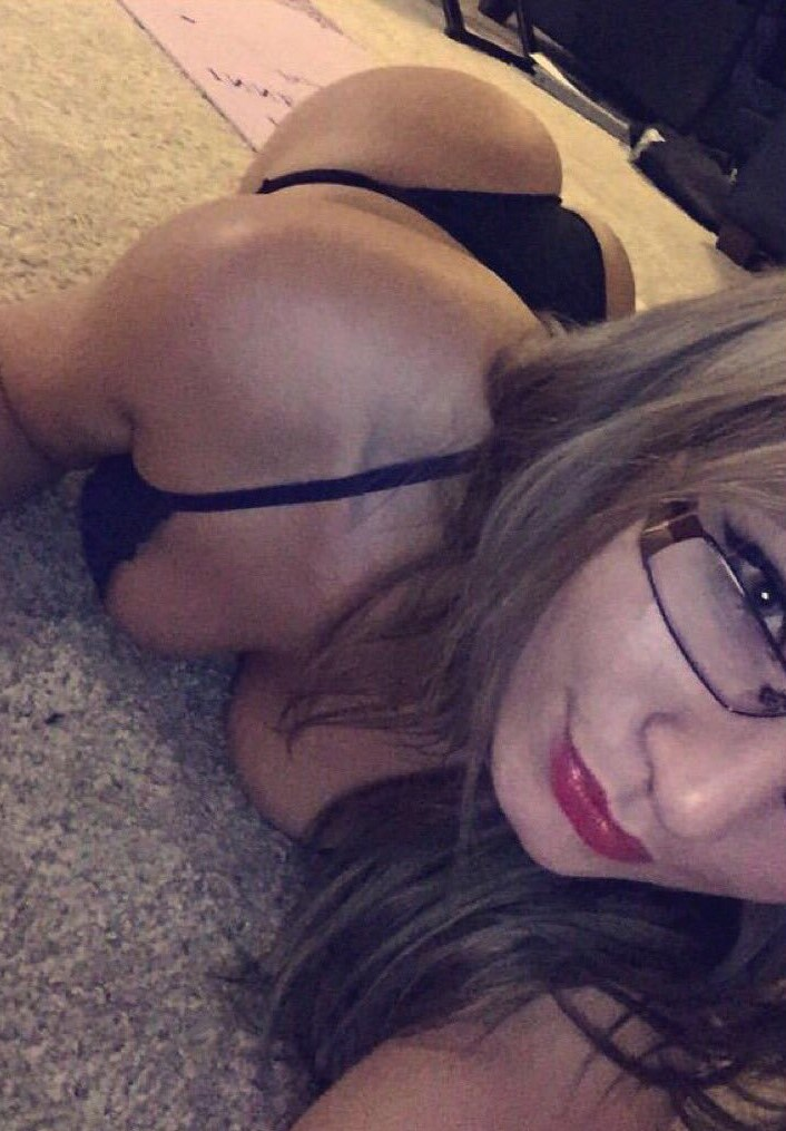 Youtuber star Zoie Burgher laying down taking a hot selfie