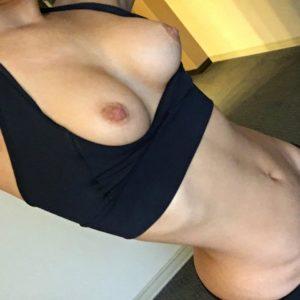 Adult pornstar Eva Lovia in sports bra showing off tits