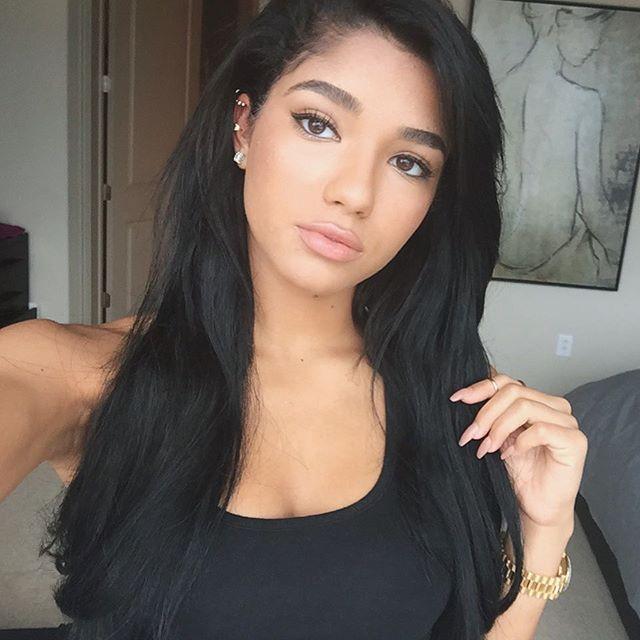 beautiful instagram star yoventura taking a selfie and tilting her head