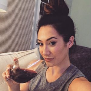 Hot Eva Lovia drinking wine