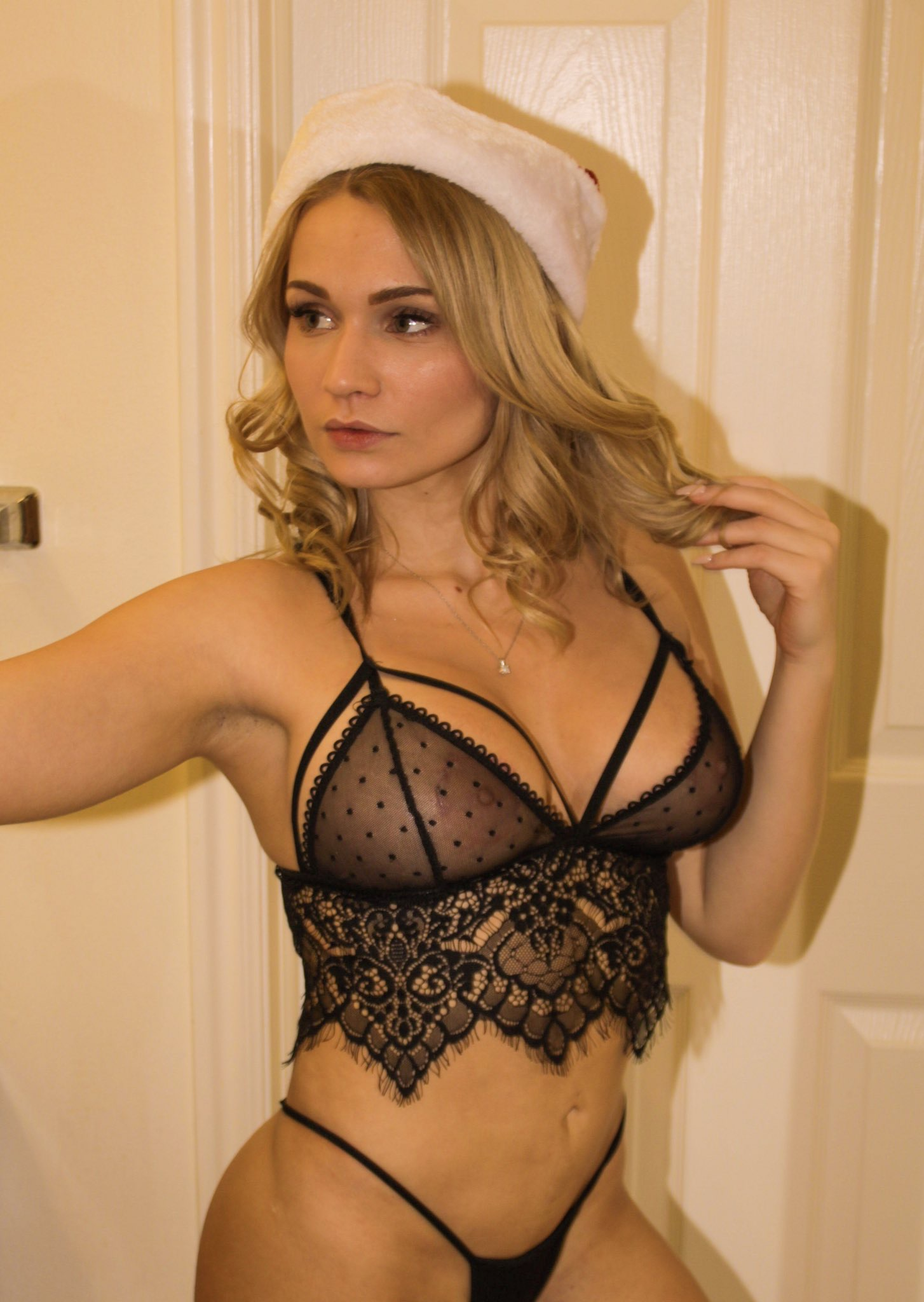 Beauty youtuber in black lingerie looking sexy