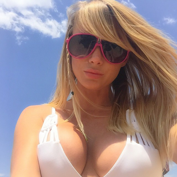 Instagram model Sara Jean Underwood in white biikini and sunglasses