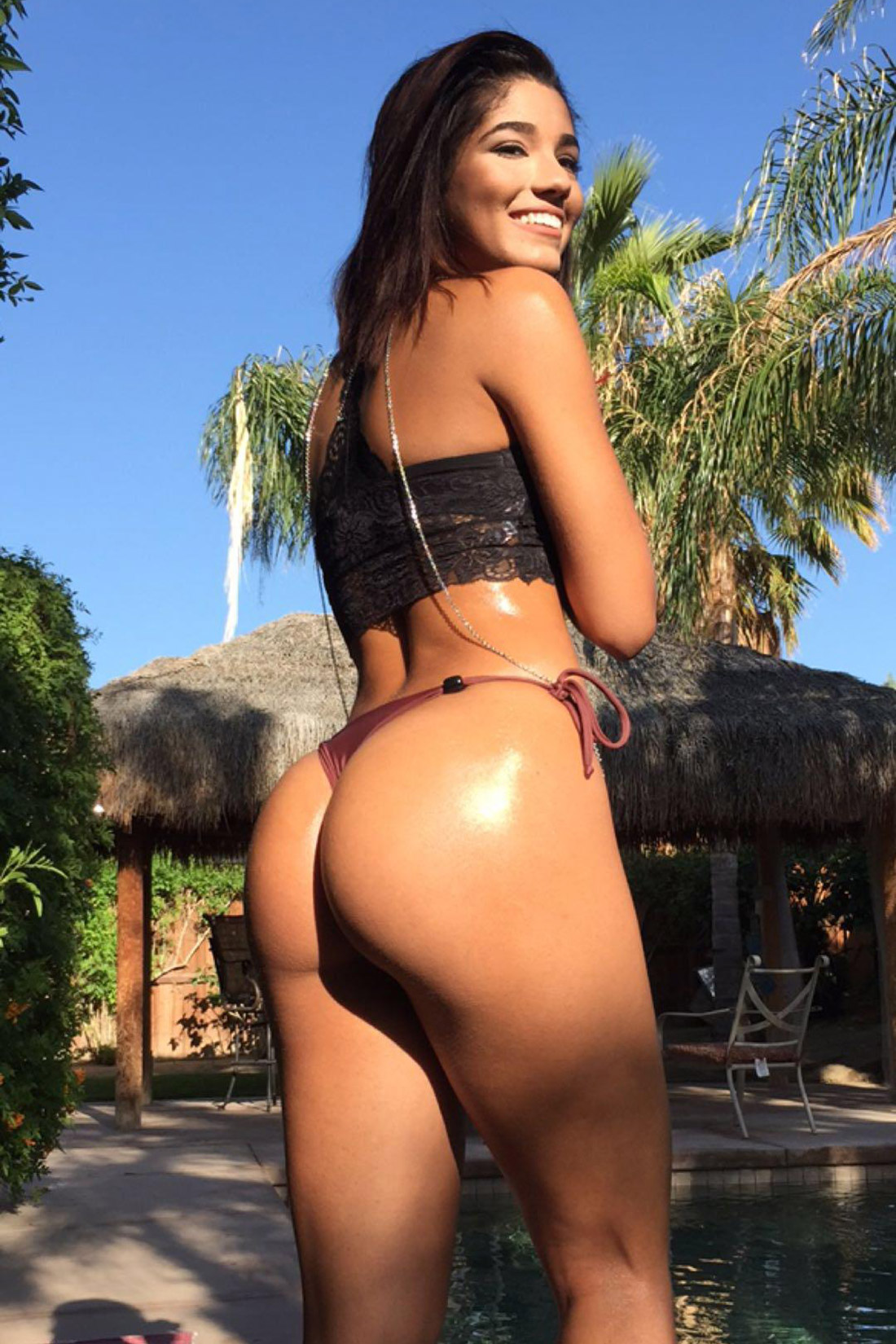naughty pic of yovanna ventura in string bikini thong looking back at the camera
