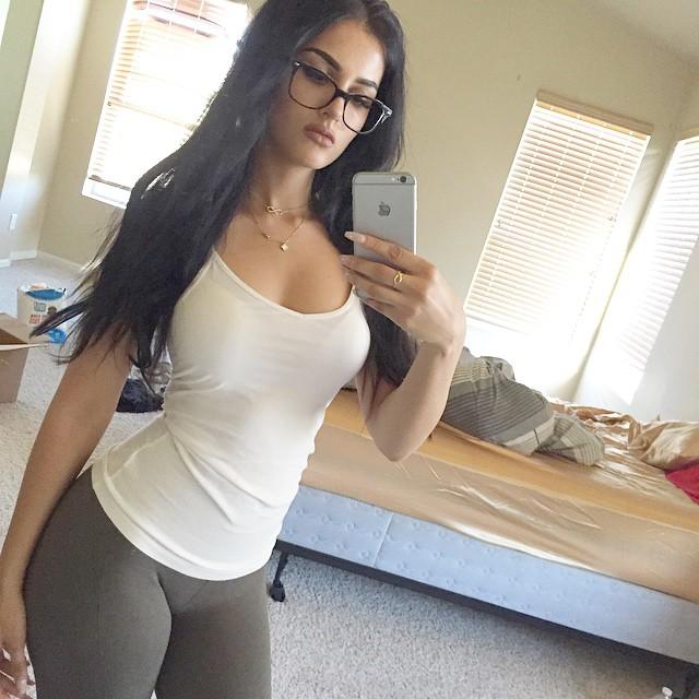 gamer sssniperwolf in sexy tank top taking a instagram mirror photo
