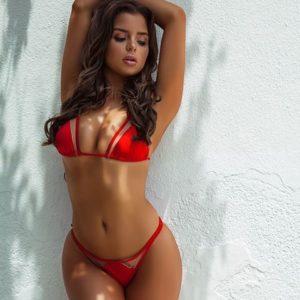 celeb demi rose mawby in tiny red bikini against a white wall