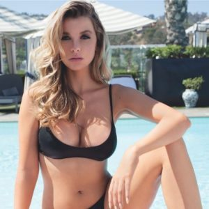 blonde instagram babe emily sears in black bikini next to pool