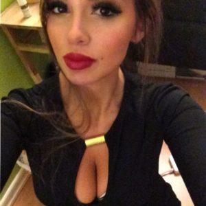 ig model ini.helen showing off her breasts in black top