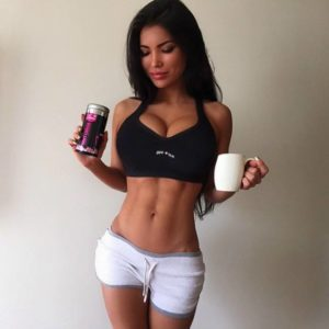 gorgeous russian model svetlana bilyalova in white shorts and sports bra showing off her nice abs