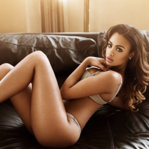 beauty analicia chaves modeling sexy lingerie on a couch