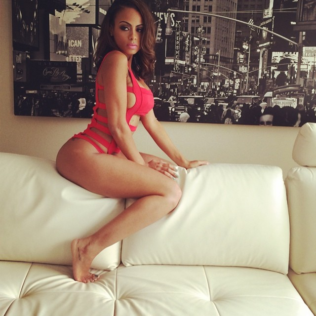 ig model analicia chaves riding a couch in a red lingerie