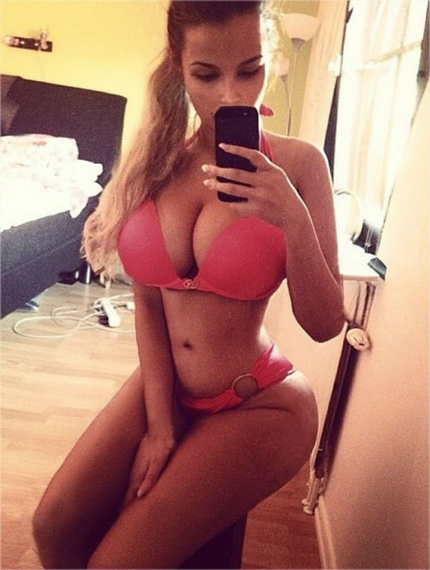 IG model ines helene in revealing hot pink bikini taking a selfie sitting down