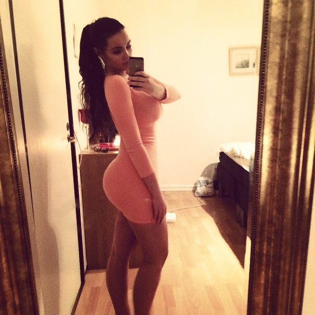 gorgeous model ines helene taking a mirror pic in tight pink dress