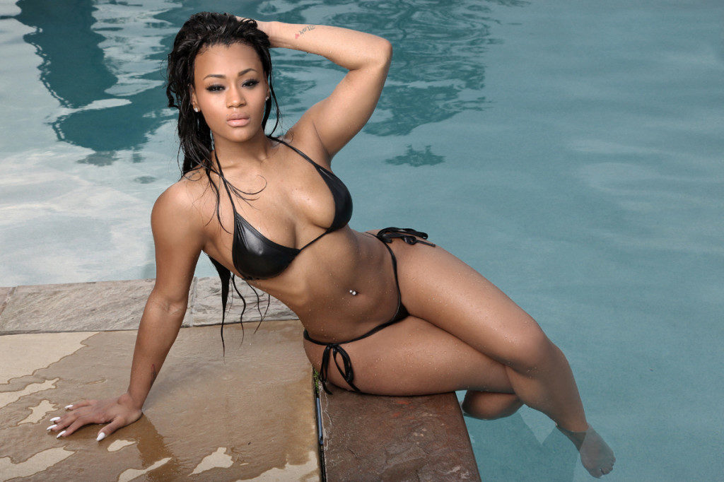 model lira galore in a black bikini next to a pool