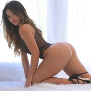 missgenii brazilian japanese instagram model showing off her round booty on all fours