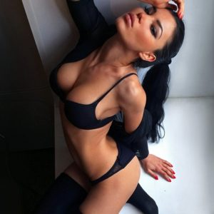 svetlana bilyalova in sexy black lingerie sitting and showing off her cleavage